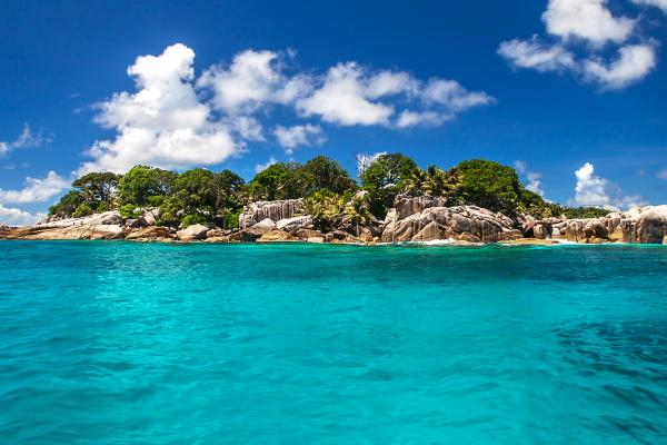 A view of the Seychelles coastline, which can be visited with a cheap holiday package from Flight Centre.