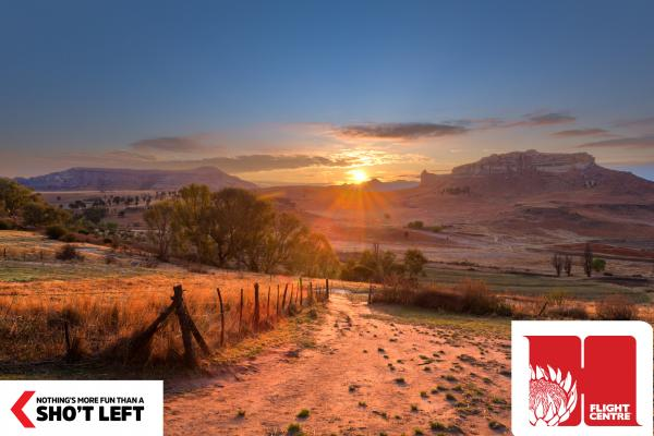 The sun rises over a beautiful mountainous vista in the Free State, which can be toured with a Homegrown holiday package from Flight Centre.