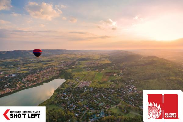 Gauteng's Magaliesberg region and a hot air ballon are in view and can be toured as part of a Homegrown holiday package from Flight Centre.