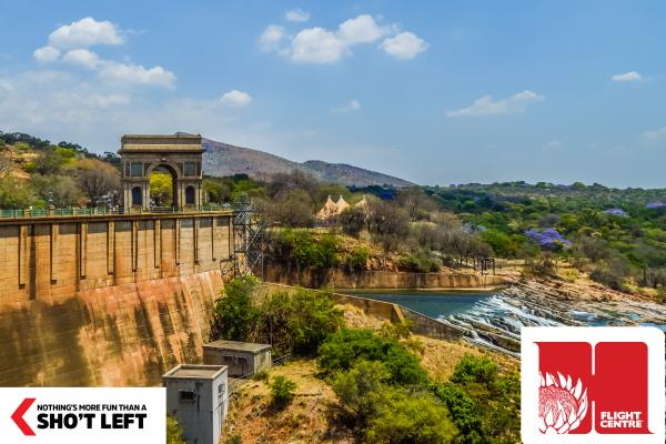Water flows out from the Hartbeespoort dam wall in the North West, which can be explored with a Homegrown holiday package from Flight Centre.